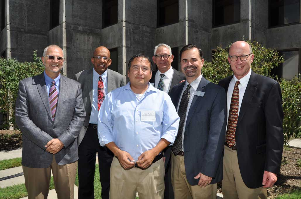 Stuart Butzier, Modrall Sperling shareholder, Alfred Mathewson, Co-Dean of the School of Law, Pablo Padilla, 2004 Sperling Scholarship recipient, Lynn Slade, Modrall Sperling shareholder, Sergio Perea, Co-Dean of the School of Law, and Walter Stern, Modrall Sperling shareholder and present.